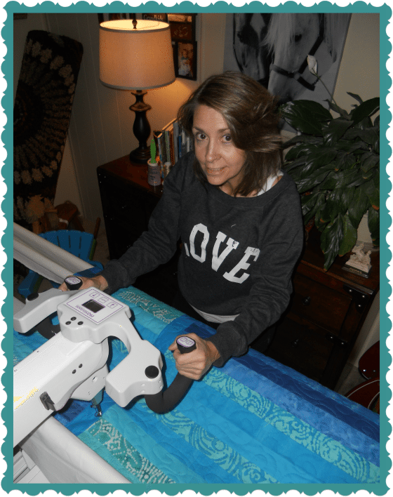My Sis Linda Quilting by Machine